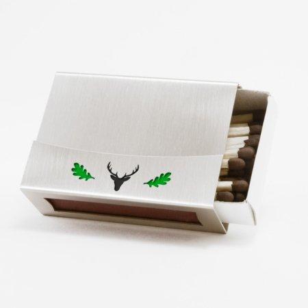 Streichholzschachtel - Huelle aus Edelstahl mit gruenem Eichenlaub und schwarzem Hirschkopf