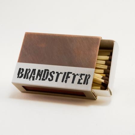 """Streichholzschachtel - Huelle """"Brandstifter"""" aus Edelstahl und Kupfer mit schwarzer Schrift"""