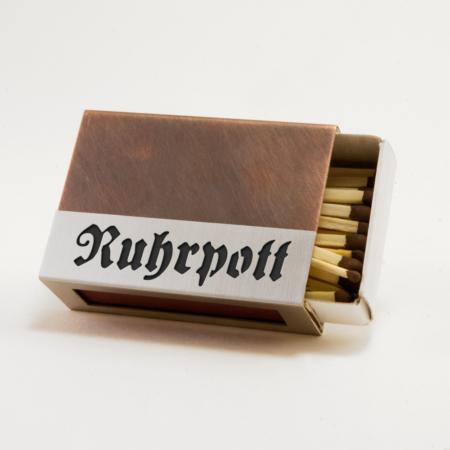"""Streichholzschachtel - Huelle """"Ruhrpott"""" aus Edelstahl und Kupfer mit schwarzer Schrift"""