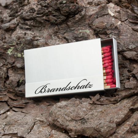 """Kaminholzschachtel - Huelle """"Brandschatz"""" aus Edelstahl mit schwarzem Text"""